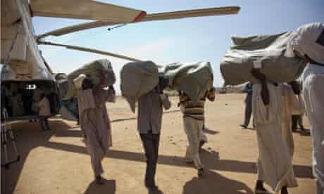 Volunteers unload humanitarian aid in Darfur
