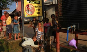 Children play by a borehole in Nigeria