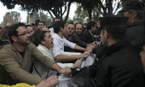 Employees of a Cyprus bank protest outside the parliament building in the capital, Nicosia