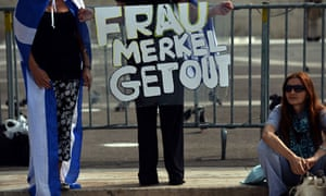 A protester in Greece hold an anti-German banner outside the parliament in Athens