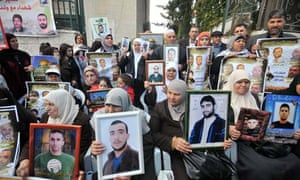 Palestinians protest outside the International Red Cross offices