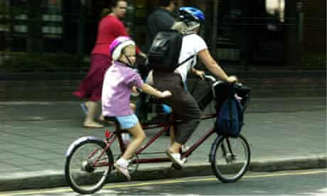 A family cycling on a tandem bike