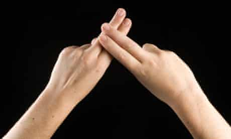 The word 'deaf' is spelled in sign language