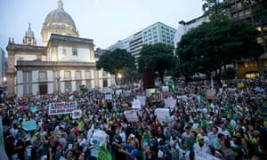 People gather for an anti-government protest in Rio