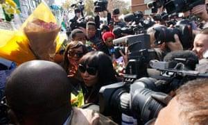 Nelson Mandela's granddaughters, Zaziwe Dlamini-Manaway, centre, and Tukwini Mandela, centre left