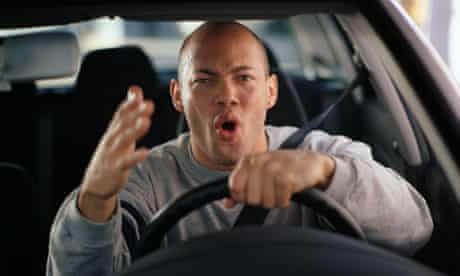 Man driving with road rage