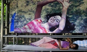 A Bangladesh homeless woman sleeps at a bus stand in Dhaka on September 18, 2013. The latest Millenn