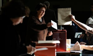 A Uruguayan woman casts her vote at a polling station in Montevideo