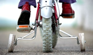 Bike blog : Young child on a bicycle with stabilizers or training  wheels