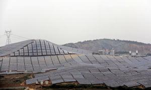 Green energy in China : Solar panels part of 100 Megawatt Solar farm In Wuhu