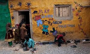 MDG : Child rights : Pakistani schoolchildren enter a classroom in school, Pakistan