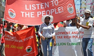 MDG : IRIN news : Global Day of Action in Durban