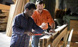 An Eritrean asylum seeker working at a sawmill in Einsiedeln Abbey, Switzerland, where 30 Eritreans have been given refuge.