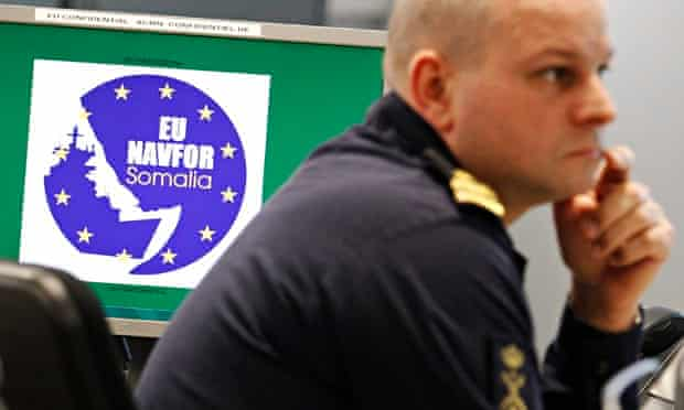 A member of staff works at the EU naval force operations headquarters in London.