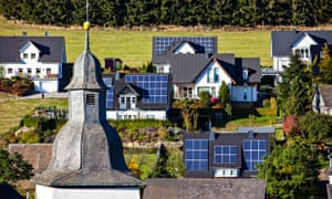 Solar panels on the roofs of residential houses, Oberkirchen, North Rhine-Westphalia, Germany
