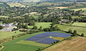 Aerial view of a solar farm - a field of solar panels Sibford Ferris, Oxfordshire UK