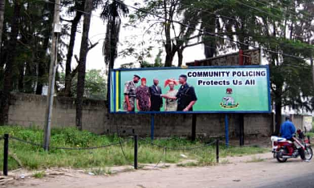 MDG : Corruption in Nigeria : Billboard promoting community policing forces in Lagos
