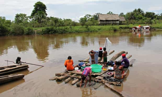 Kukama women and children doing washing in river  in Cuninico