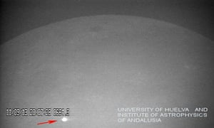 the impact of a large meteorite on the lunar surface of the moon