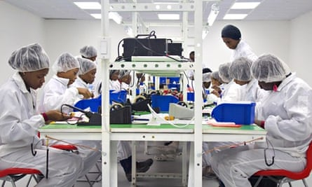 MDG : Workers on Surtab tablets PC assembly line in Industrial Park of Port-au-Prince, Haiti