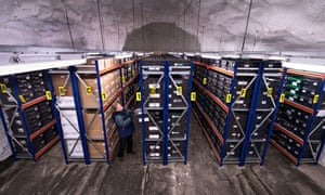 The Svalbard Global Seed Vault carved into the Arctic permafrost.