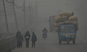 Children walk back home after school on a severely polluted day in Shijiazhuang, Hebei, China