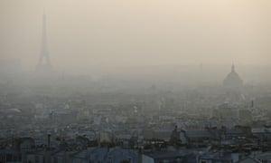 Air pollution in Paris : Eiffel tower through a haze of pollution in Paris