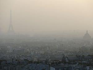 Eiffel Tower seen through haze of air pollution in Paris