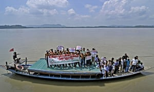 Members of AJYCP protest in Brahmaputra River against the construction of mega dams, India
