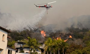 "California fire :  so-called the ""Colby Fire"" : A helicopter drops water"