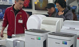Customers shop for air purifier at an appliance store in Beijing, China