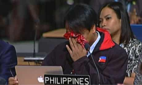 Yeb Sano of the Philippines breaks down in tears at the Warsaw climate conference COP19