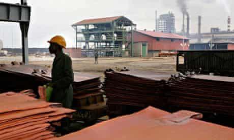 MDG : Glencore in Zambia :  worker stacks copper plates at Mopani Copper Mine Plc's Mu