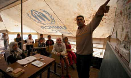 MDG: Syrian refugee children being taught in a tent