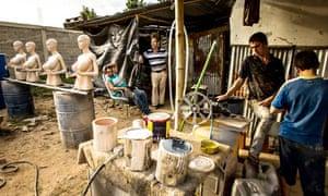 Men construct mannequins in Valencia, Venezuela