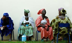 Women wait for the start of a gathering