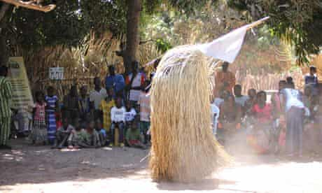 MDG : Casamance community forest project : Festival goers watch the Kompo, Senegal