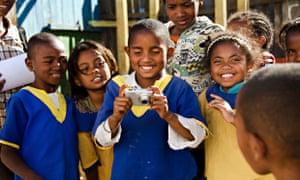 MDG : Schoolchildren taking pictures during Art in All of Us activities