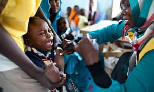 MDG: a child receives a vaccination