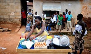 MDG : Ghana economy in trouble : A Ghanaian woman cooks a meal in Accra