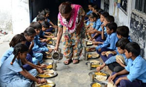 MDG : India school free meal : schoolchildren eat their free midday meal at a government school