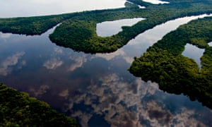 Clouds reflecting in a river in Amazon near Manaus, Brazil
