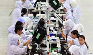 MDG :  Electronics industry in Malaysia : Women employees on factory line at Flextronics