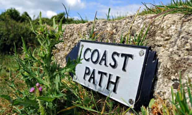 Extending coatstal path around UK : a coast path sign near helford in cornwall,