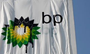 Greenpeace activists place a banner with the British Petroleum (BP) Logo