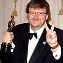 Michael Moore with his Oscar for best documentary