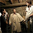 The Coen brothers and Tom Hanks on the set of The Ladykillers