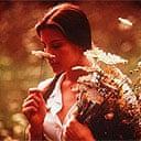 Liv Tyler smelling flowers in Stealing Beauty (1996)