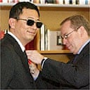 Wong Kar Wai, Cannes 2006 jury president is awarded the insignia of the Legion of Honour by French Culture Minister Renaud Donnedieu de Vabres May 21, 2006.