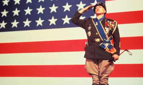 George C Scott, as General Patton, salutes the American flag